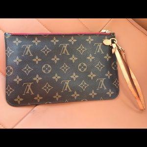 LIKE NEW Louis Vuitton monogram pochette wristlet.